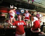 Santas have taken over a bar